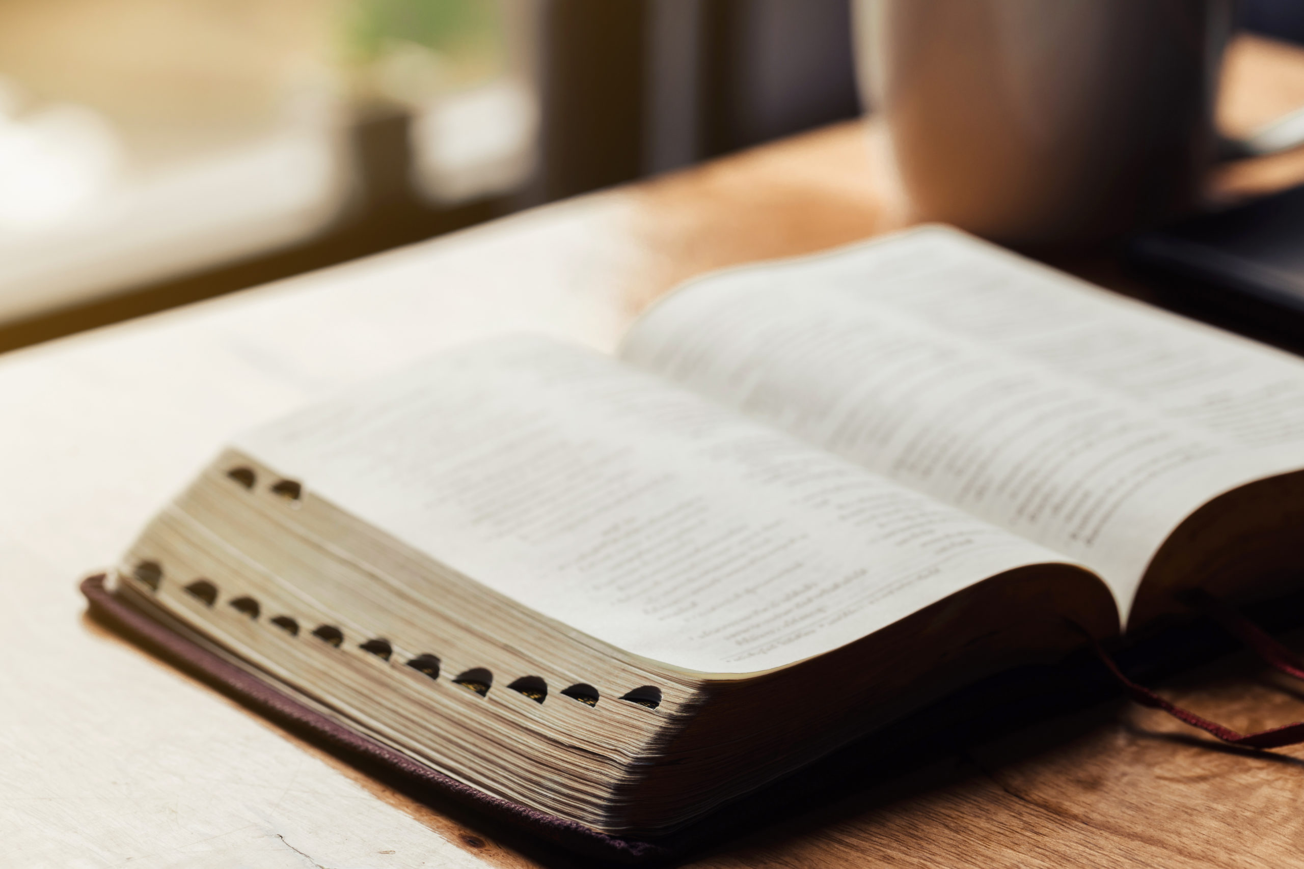 Open bible on wooden table